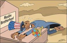 """A cartoon by an Egyptian newspaper showing the Obama-administration crying over the tomb of the """"Muslim Brotherhood"""" after the 30th of June revolution deposing the groups leaders. It is believed that the Obama-administration were from the strongest supporters of the MB radical group, under the name of democracy."""