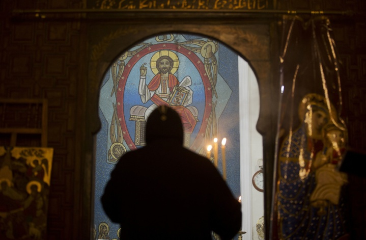 2018-01-21 Praying next to the art at Nativity of Christ Coptic Orthodox Church in Cairo AlAhram
