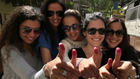 2018-02-23 Egyptian women with ink stained fingers after voting in post-revolution elections