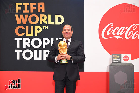 2018-03-15 President Elsisi of Egypt holding the Fifa World Cup during its tour in Cairo Youm7
