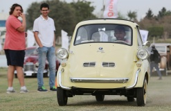 A yellow classic BMW Isetta model is on display at the 7th Cairo Classic Meet in Cairo